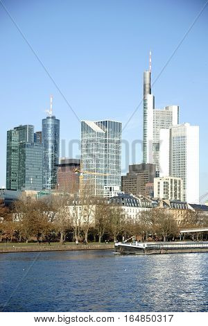 The skyline of the banking district in Frankfurt behind the River Main.