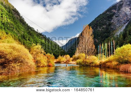 River With Crystal Clear Water Among Mountains And Woods