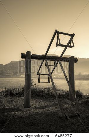 Old wooden totter in the local garden. Filter effect style