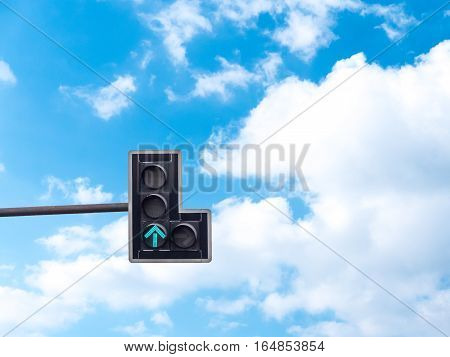 Green color on the traffic light with a beautiful blue sky in background Go straight