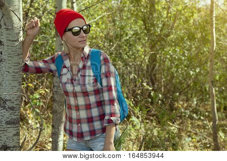 Female Hiker Staying Inside Forest  With Backpack  And Joyful