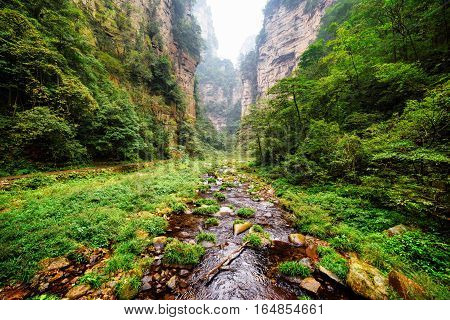 Beautiful View Of River With Clear Water At Bottom Of Deep Gorge