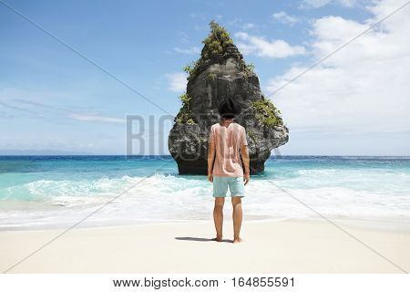 Stylish Young Caucasian Male Adventurer With Bare Feet Standing In Front Of Deserted Stone Island Wi