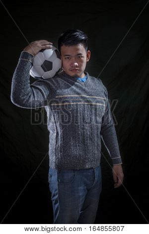 portrait asian soccer mania man on black