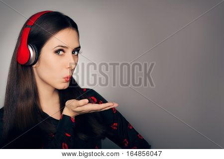 In Love Girl with Headphones Blowing Kisses