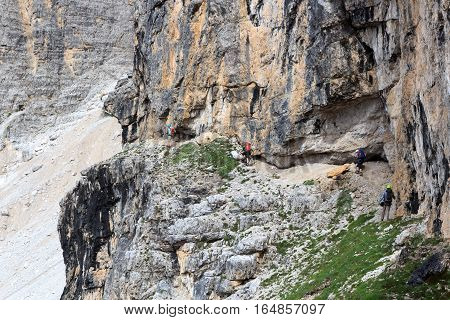 People Climbing The Via Ferrata Severino Casara In Sexten Dolomites Mountains, South Tyrol, Italy