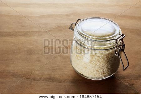 Jar of Breadcrumbs on a Wooden Background
