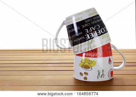 Stack of Cups on a Wooden Background