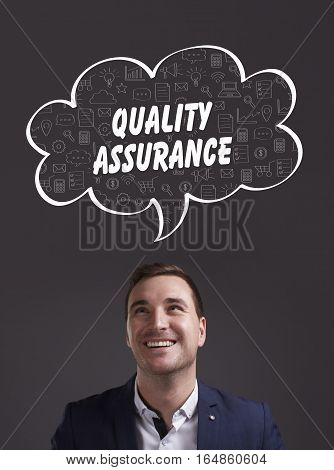 Business, Technology, Internet And Marketing. Young Businessman Thinking About: Quality Assurance