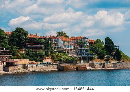 Coastal view of Nesebar city houses and embankment. Nesebar Bulgaria. Ancient town on the Black Sea coast
