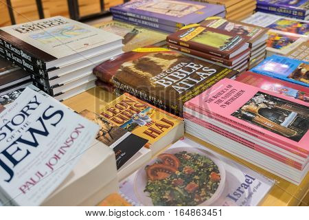 QUMRAN ISRAEL - JANUARY 06 2017: Many israely books for sale at gift shop