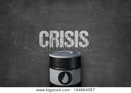 Crisis text on black blackboard with oil barrel
