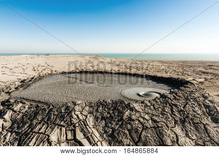 Crater of mud volcano, gurgling volcanic mud