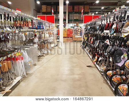 CHIANG RAI THAILAND - NOVEMBER 29 : Supermarket aisle in area of kitchen utensils on supermarket stand or shelf on November 29 2016 in Chiang rai Thailand.