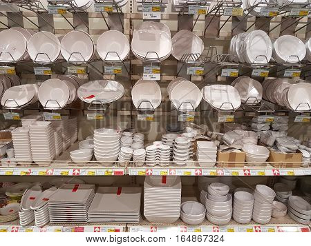 CHIANG RAI THAILAND - NOVEMBER 29 : various brand of white plastic dishes in packaging for sale on supermarket stand or shelf on November 29 2016 in Chiang rai Thailand.