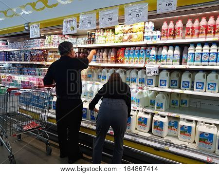 CHIANG RAI THAILAND - NOVEMBER 29 : unidentified asian people buying milk and dairy products in packaging for sale on supermarket stand or shelf on November 29 2016 in Chiang rai Thailand