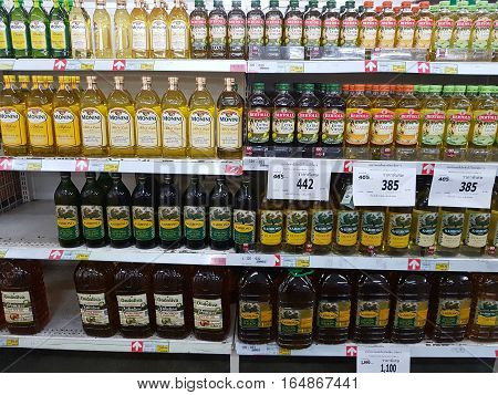 CHIANG RAI THAILAND - NOVEMBER 29 : various brand of olive oil on supermarket stand or shelf on November 29 2016 in Chiang rai Thailand.