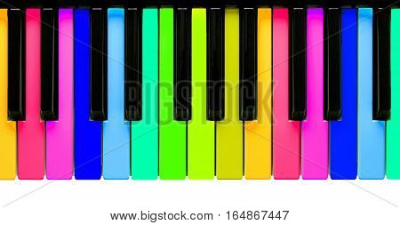 Rainbow piano keys isolated on a white background