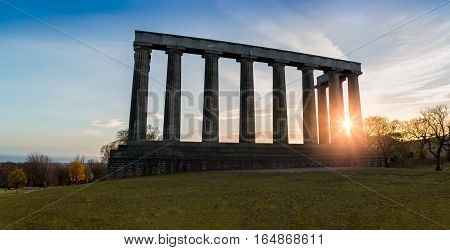 National monument of Scotland on top of Edinburgh's Calton hill at sunrise