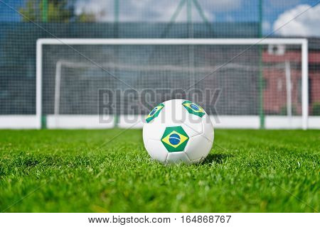 Brazilian soccer ball on penalty spot, toned image