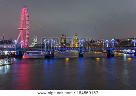 London skyline at night with embankment bridge big ben and houses of parliament at the background as seen from Waterloo bridge