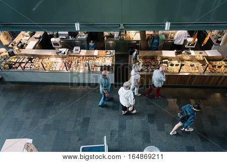 Rottedam The Netherlands - August 6 2016: Foodie shops. The Markthal is a residential and office building with a market hall underneath. It was designed by architectural firm MVRDV