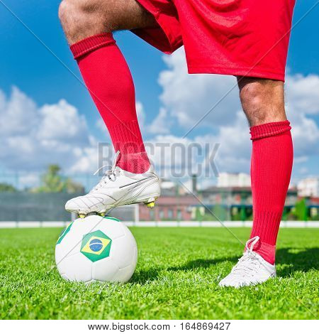 Soccer Player With Brazilian Ball