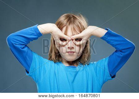 Boy in Blue Top Looking Through Fingers as Binoculars