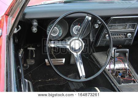 a Dashboard of a vintage sports car