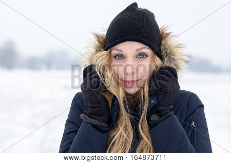 Cold Young Woman In A Freezing Winter Landscape
