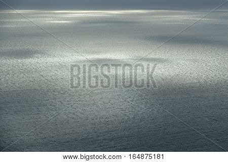Closeup of vast sea with sky reflections