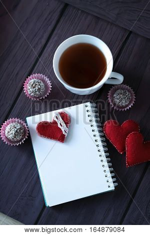 Chocolate Balls, Tea And Notebook