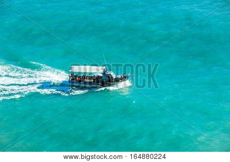 Fishing boat drifted in the sea. Turquoise sea