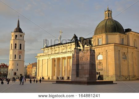 VILNIUS, LITHUANIA - DECEMBER 29, 2016: Cathedral Square with from left to right: The Belfry (Cathedral Clock Tower) and the Cathedral - Gediminas Monument in the foreground