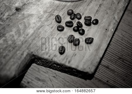 Coffee beans on wooden board in black and white style