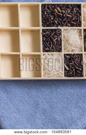 Wild black and white dry rice closeup macro shot on blue jeans, Sensitive focus