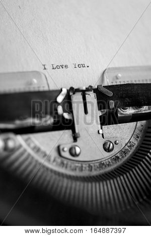Message I love you printed on typewriter machine. Copy space on fiber paper.