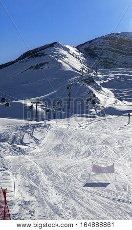 Ski Slope And Gondola Lift At Sun Winter Evening