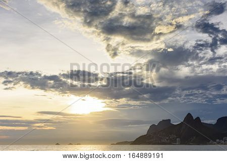 View of sunset with colored clouds at Arpoador beach in Ipanema Rio de Janeiro
