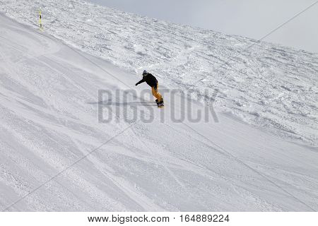 Ski and snowboarder at winter cold day. Georgia region Gudauri. Caucasus Mountains.