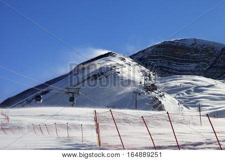 Gondola Lift On Ski Resort At Windy Winter Day