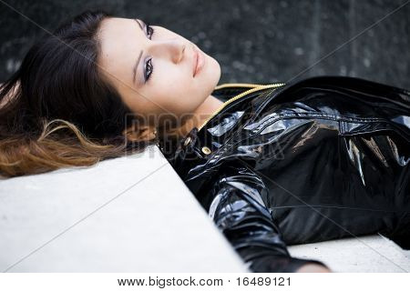 Beautiful woman in a leather jacket