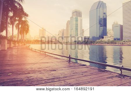 Landscape building modern business district of bangkok at twilgiht sky beautiful water reflection.
