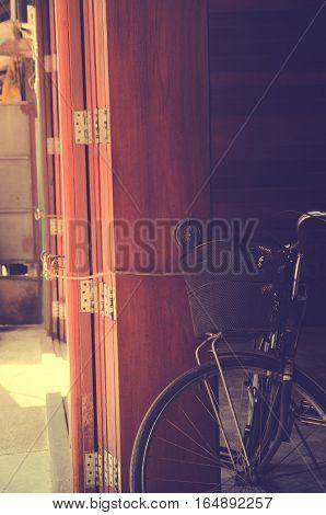 vintage bicycle on vintage wooden house wal