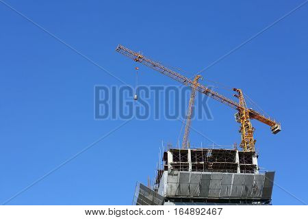 Machinery Crane Hoisting Cement Bucket Mixer Pouring In Construction Site Building