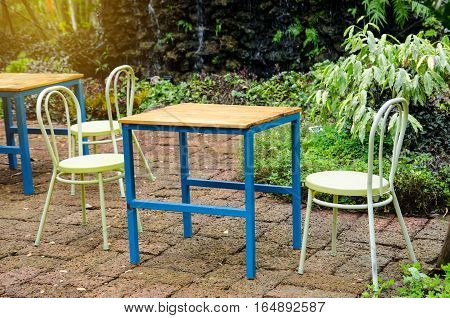 Beautiful wooden garden chair in the garden