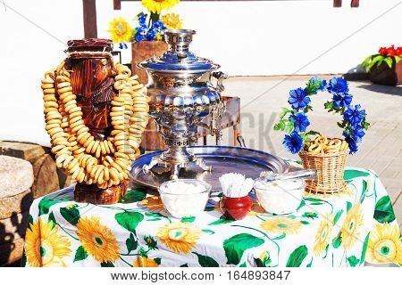 Russian samovar with bagels on Maslenitsa. Bakery and tea