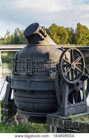 Old Bessemer furnace from an old steel mill in Sweden. Driven by hand with a crank and a large gearbox.