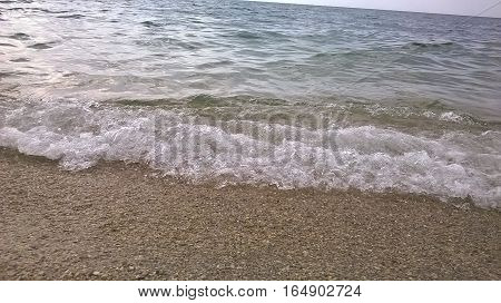 Beautiful landscape: the coast, the wave lapping on the shore