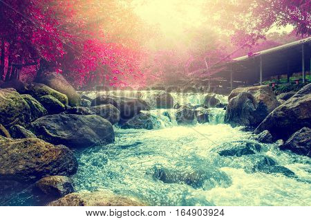 Wonderful Waterfall with rainbows in deep forest at national park Thailand.